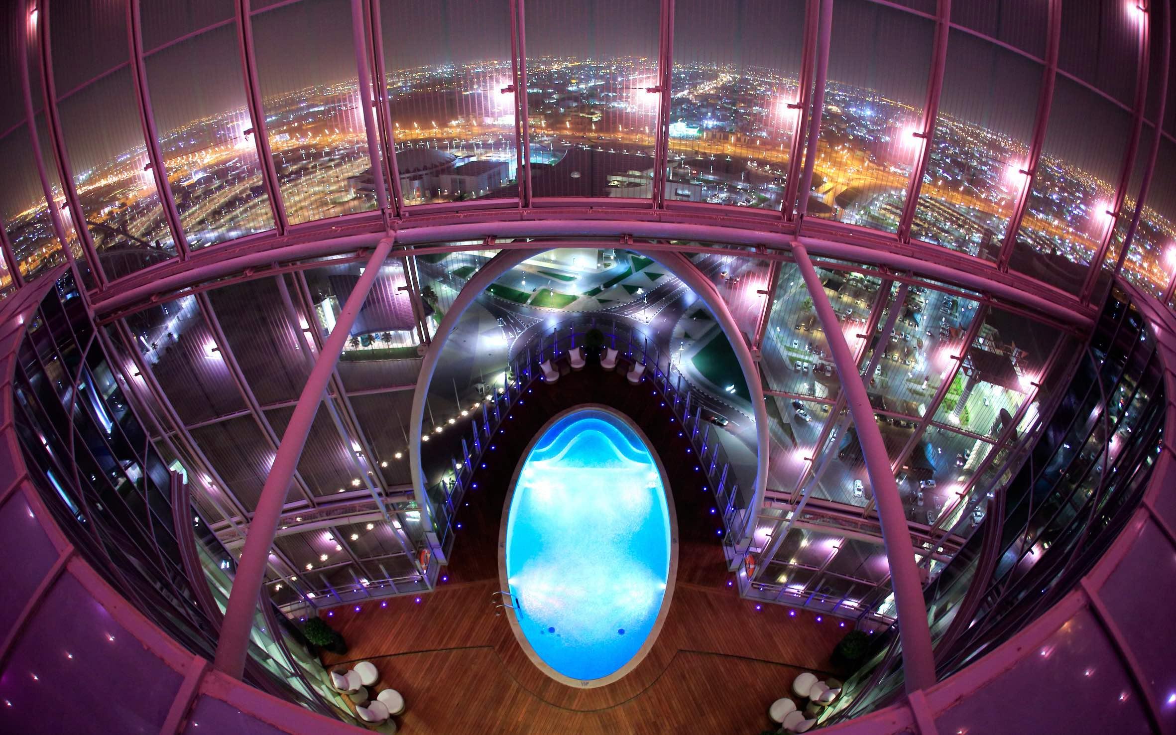 Unwind by the pool overlooking Doha